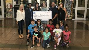 Greystone Elementary PTA and student with big Chrysler check