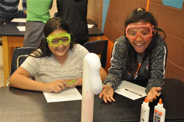 This is a photo of two students working with dry ice in science club.