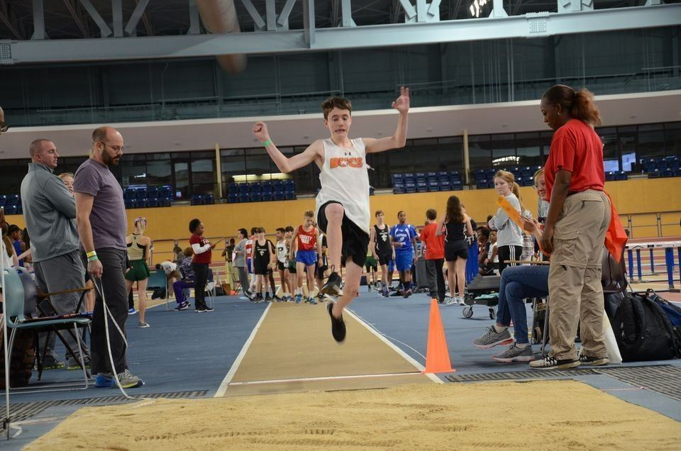 This is a photo of an indoor track athlete at an event.