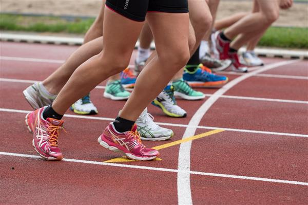 track and field runners on track