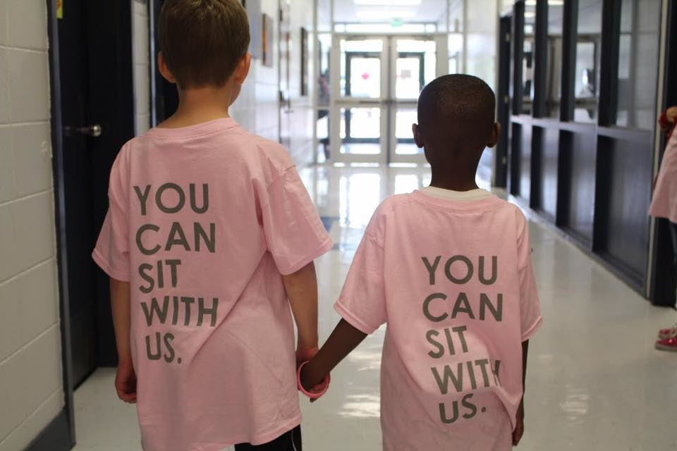 Photos of students on Be Kind Day wearing their pink shirts.
