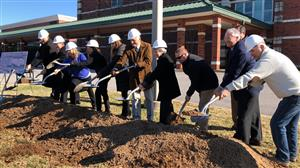 Berry groundbreaking with shovels tossing dirt
