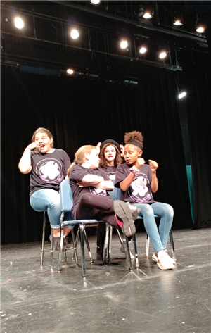 Improv acting by students on stage